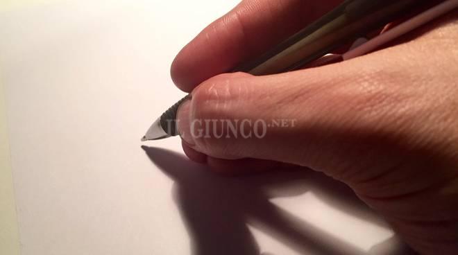 mano che firma penna dislessia