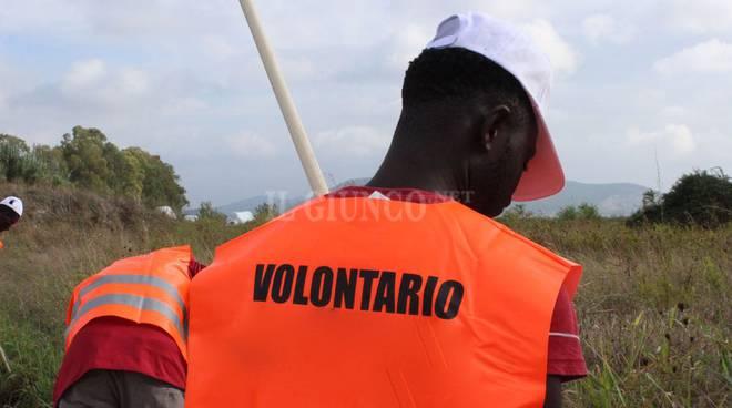 migranti volontari